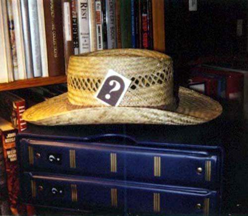 John R. Bacak uses his tattoo in his hat (2002)