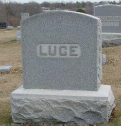 Carl E Luce