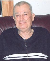 Roland E. Rollie Coats
