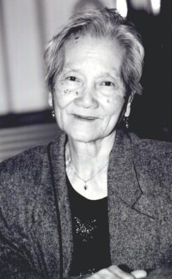 Carlina Dela <i>Cruz</i> Achurra