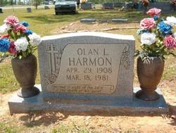 Olan L Harmon