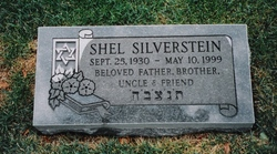 gray gravestone reads with star of David and flowers on a book, written on scroll image : Shel Silverstein Sept 25 1930 - May 10 1999 Beloved father brother uncle and friend, followed by Hebrew characters; photo published by Ginny M on FindAGrave.com