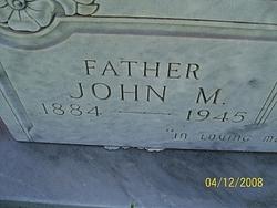 John M Carlile