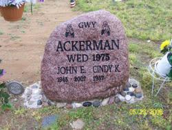 John E. Ackerman