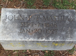 John P T Mathias