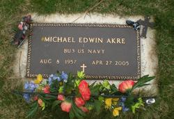 Michael E Akre