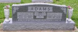 Claude A Adams