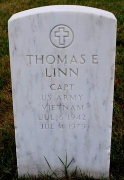 Thomas E Linn