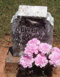 Oliver J Toumbs
