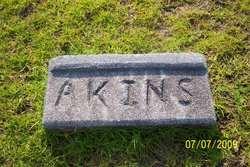 John M. Akins