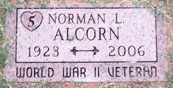 Norman L Alcorn