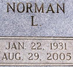 Norman L Madill