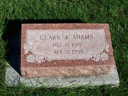 Clark J Adams