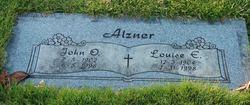 Louise E Alzner