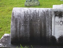 John H Holcombe