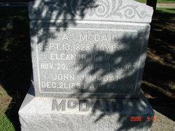 John J McDaid