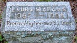 Laura M. Adams