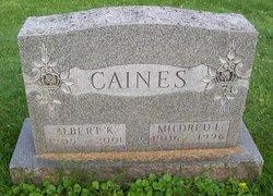Albert K Caines