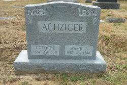 J George Achziger