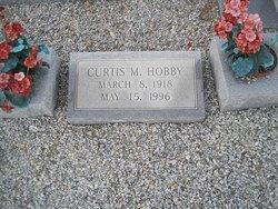 Curtis M Hobby