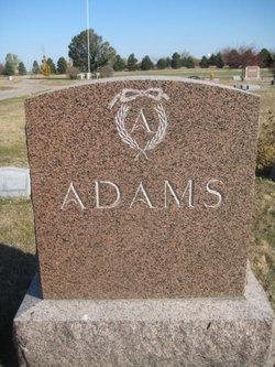 Harrie E Adams