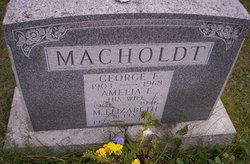 George E Macholdt