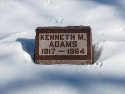 Kenneth M Adams