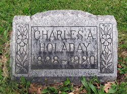 Charles A Holaday