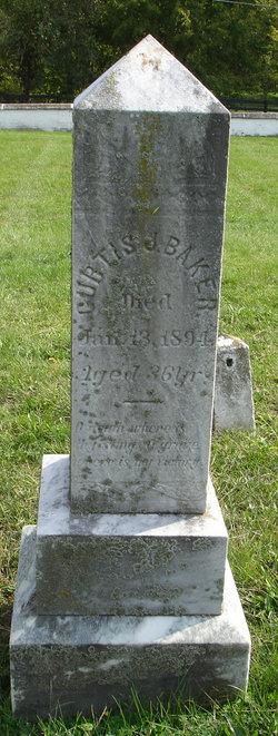 Curtis J Baker