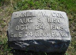 Daniel W Cox