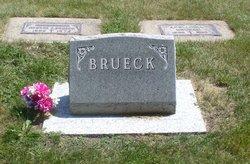 George E Brueck