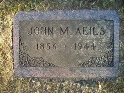 John M Aeils