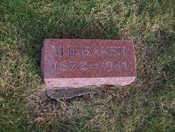 M D Baker