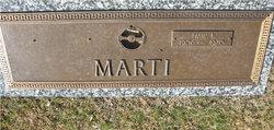 Paul E Marti