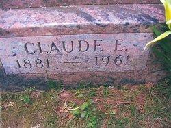 Claude E Brown