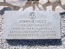 John E Huls