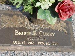 Bruce E Curry