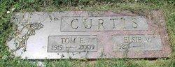 Tom E. Curtis