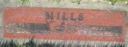 Earl B Mills