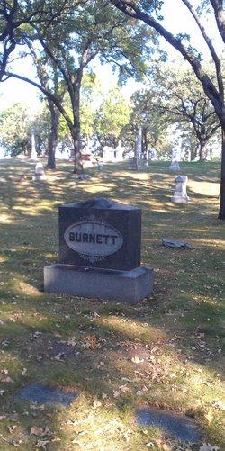 Aaron M Burnett
