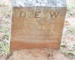 D. E. W.