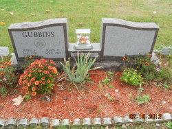 Joan E Gubbins