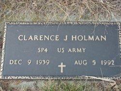 Clarence J Holman