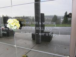 Alice M Holland