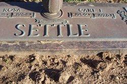 Carl E Settle