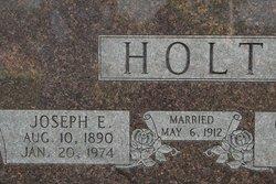 Joseph E Holt