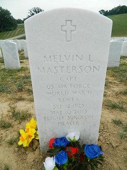 Dr Melvin L. Masterson