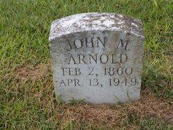 John M Arnold