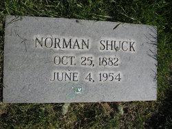 Norman W Shuck