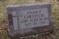 Corp Julian F Garstecki